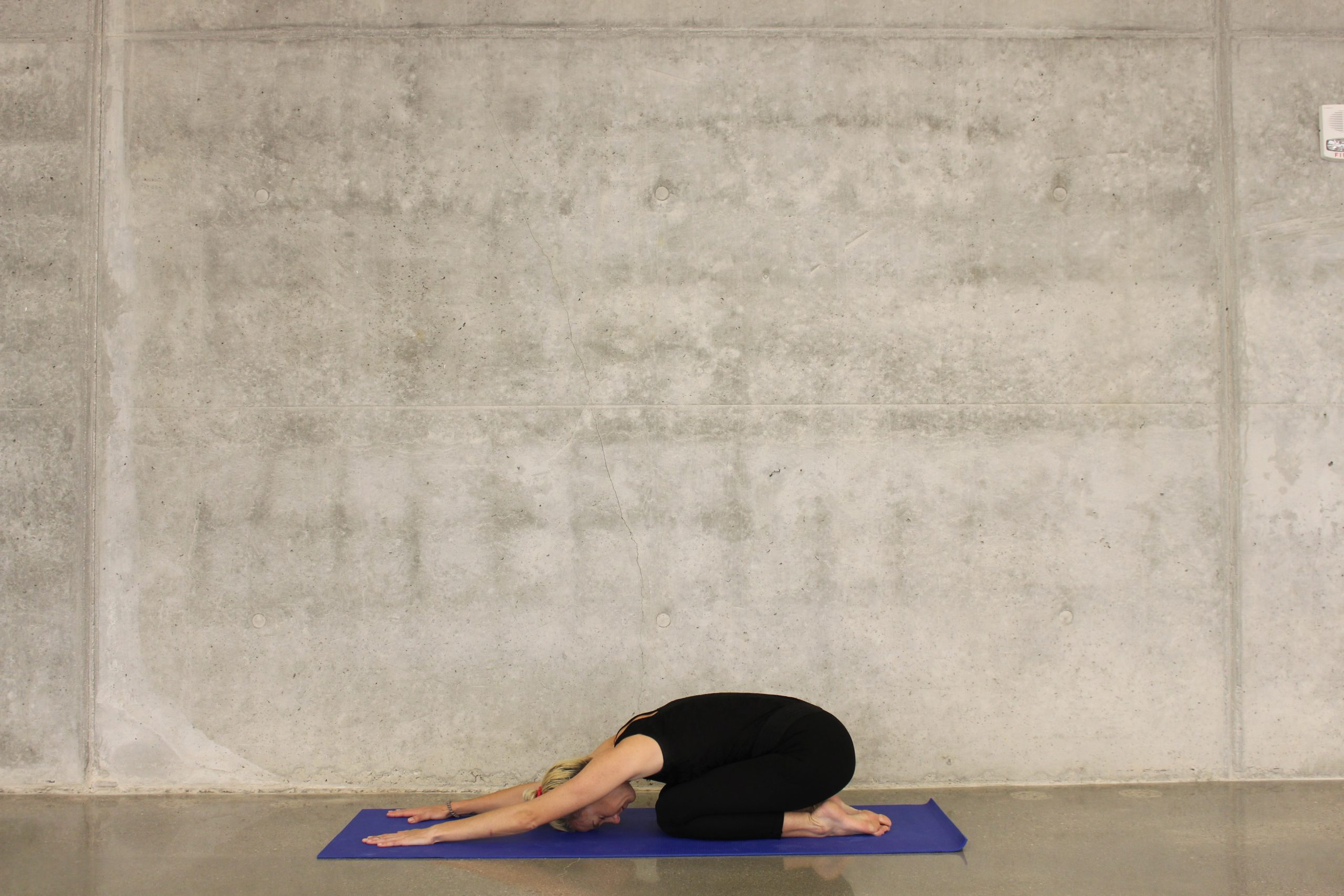 Balasana, Woman doing child's pose yoga