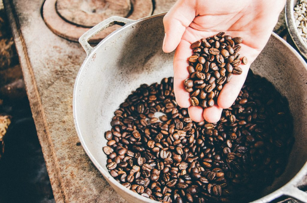 Woman playing with coffee beans to relax