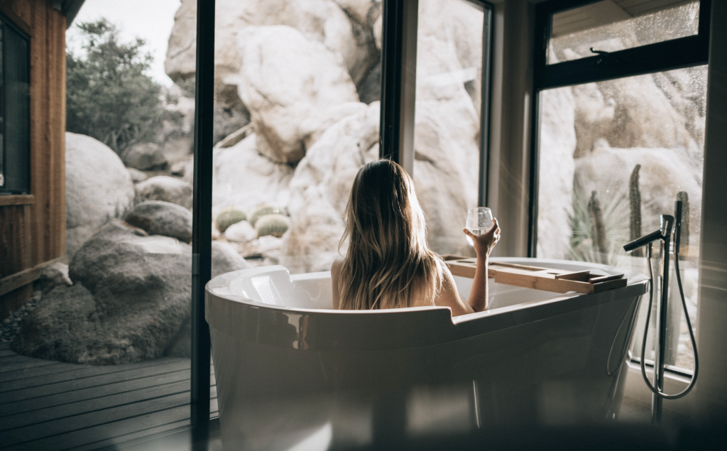 Women relaxing in bath with CBD oil to relieve stress